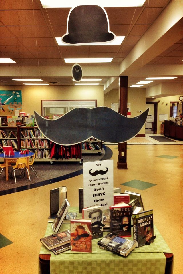 "Mustache display at the Carrico branch of the Campbell County Public Library in Fort Thomas, KY.  ""We mustache you to read these books.  Don't shave them till later!"""