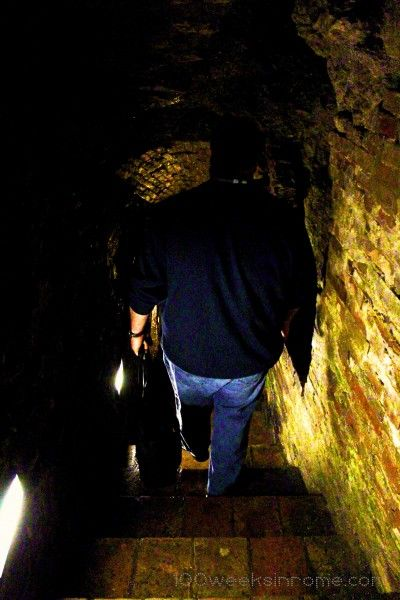 Descending into an Etruscan well in Perugia.
