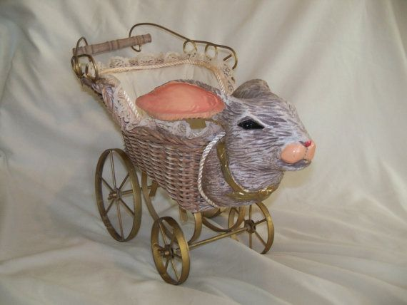Antique reproduction of a Victorian style childrens toy carriage with bunny head