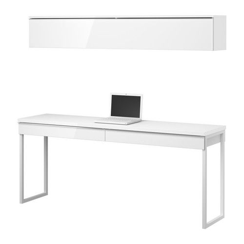 This desk is nice because its big enough for two to work. Also more modern. More shelves can be added on the sides.