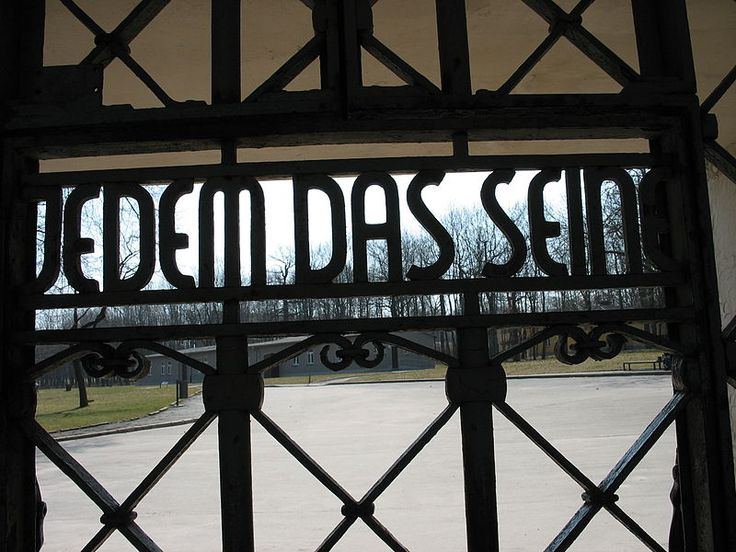 """Buchenwald Concentration Camp's main gate, with the slogan Jedem das Seine (literally, """"to each his own"""", but figuratively """"everyone gets what he deserves""""). The slogan is legible only from inside the camp."""