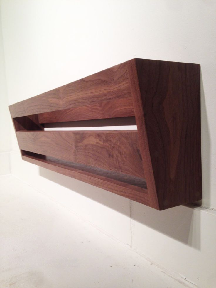 Modern Walnut Wall Mounted Shoe Rack by BitboxWoodDesign on Etsy https://www.etsy.com/listing/210210474/modern-walnut-wall-mounted-shoe-rack