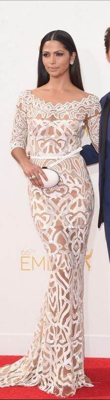 Who made Camila Alves' white long sleeve gown, jewelry, and shoes that she wore…