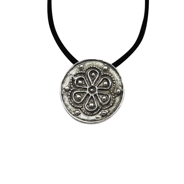 Pendant with a decorative round-shaped rosette (rodakas) with floral decoration and an engraved flower, consisting of six leaves and decorative beads. It is inspired by a mycenaean rosette bead. During the Mycenaean period, these jewelry decorated the men's and women's clothing and the diadems of the Mycenaean Queens. The pendant is offered with a black cord. 1400-1300 B.C., Mycenae Rosette Diameter: 2.5 cm Silver 925°