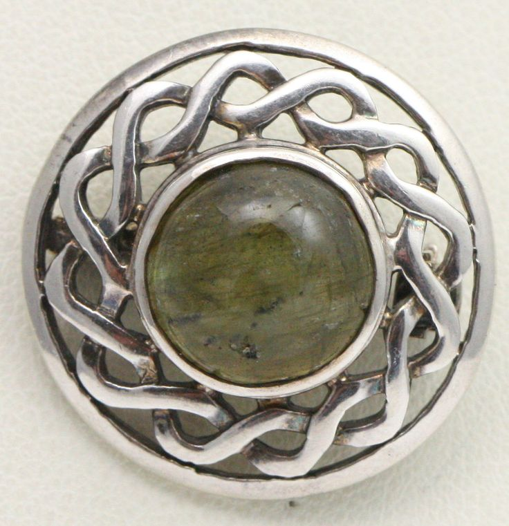025 SS Labrodorite Brooch   Labradorite honors Arianrhod, the Welsh Goddess of the Moon and Stars. Her home is the Aurora Borealis, the place where souls go when their body dies and waits to be born once again. She is also a goddess of prophecy and dream.