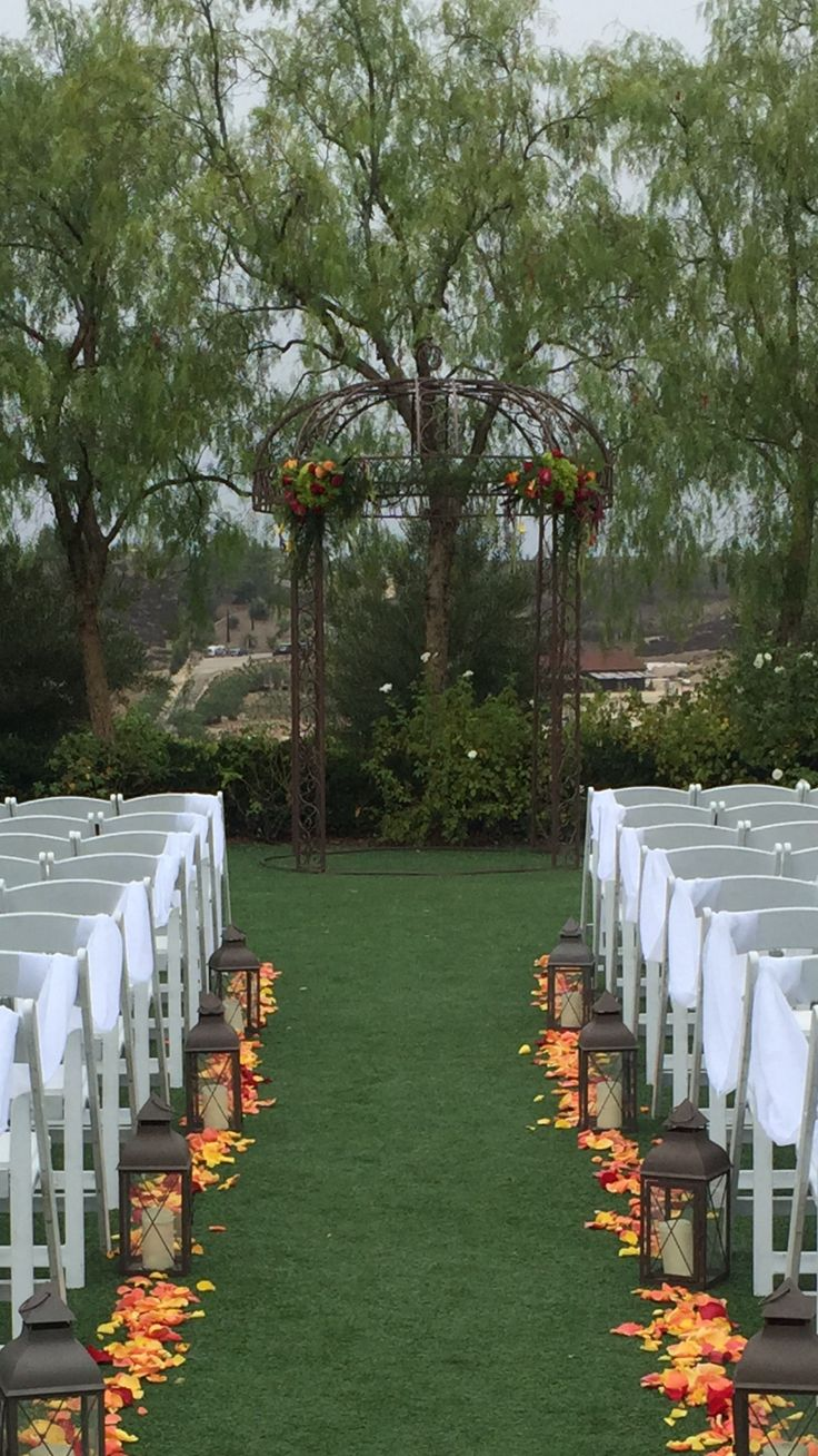 Fall wedding at Falkner Winery. Lanterns, chair draping, arbor decor, and aisle petals.  pleased actuality