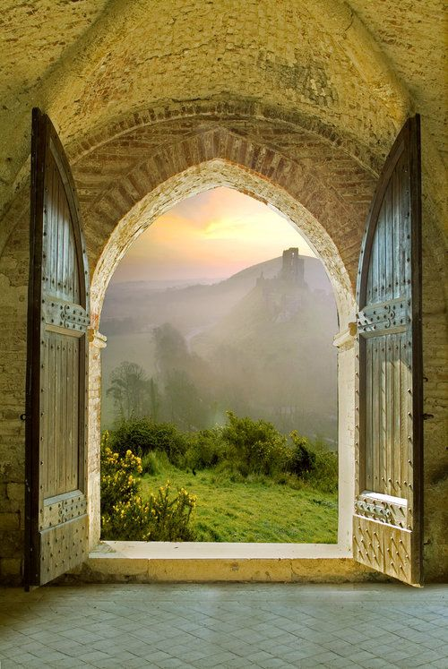 Gothic window with misty view, Tuscany, Italy