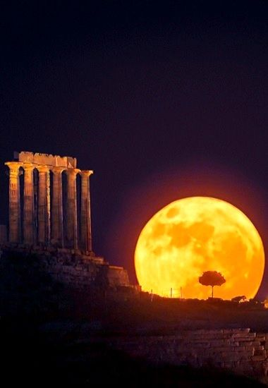 The Moon rises over the ancient Temple of Poseidon in Cape Sounion, Greece (Reuters)