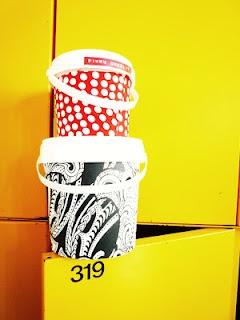 fabric/wallpaper covered yoghurt jars