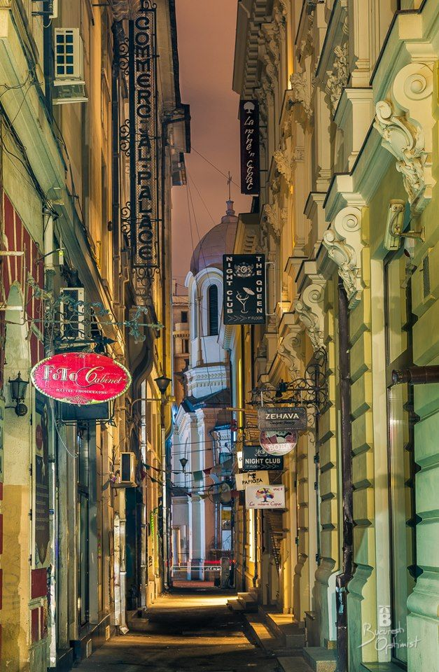This is pretty much how the Bucharest's Old/Ancient/Vintage Architectural downtown looks like. It's loaded with coffee places and this is one of those tight,colorful streets, even at night. Photo credit: Bucuresti Optimist