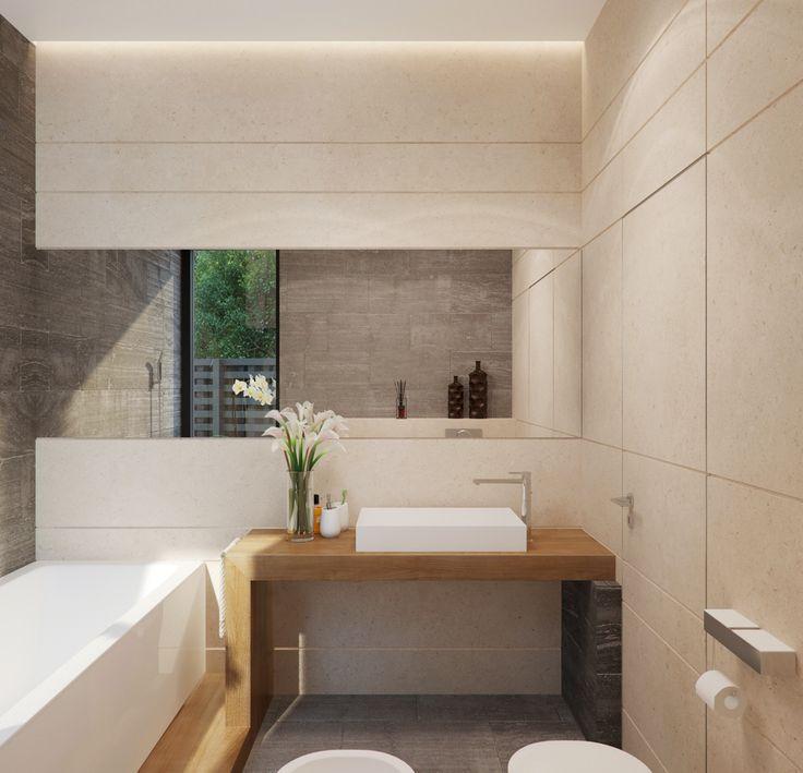 In un caso come questo, dove la parete del lavabo è sul lato corto della stanza, uno specchio stretto e lungo che va da una parte all'altra del muro aiuta ad ampliare la prospettiva e a creare riflessioni inaspettate!