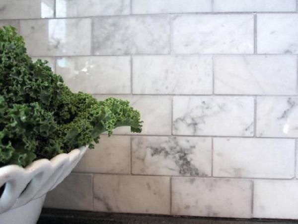 grey tumbled marble backsplash white carrara marble