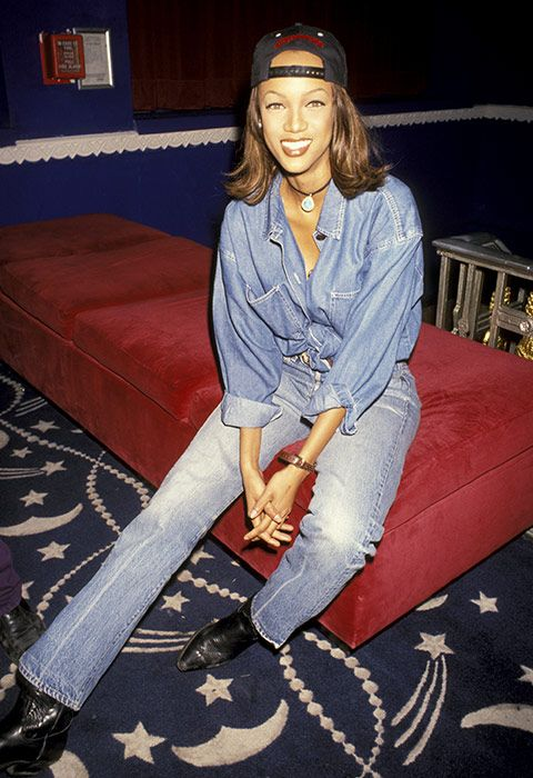 Bring on the weekend in a retro denim get-up that's got major all-year-round mileage. Follow in Tyra's footsteps and pair a knotted denim shirt with high-waisted kick flares. Swap out her old-school rope choker for a velvet alt and update the cowboy kicks with patent heeled boots.