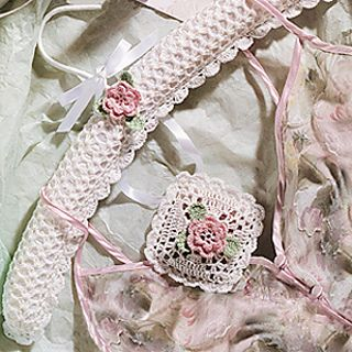 Our feminine hanger and sachet will make thoughtful tokens for a bride-to-be or fancy accessories for any romantic at heart. Adorned with petite pink flowers, the delicate shell patterns cover a ready-made padded hanger and a potpourri-filled pouch. Our designs are crocheted using size 10 bedspread weight cotton thread and a size 5 (1.90 mm) steel crochet hook.