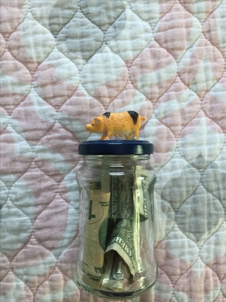 """Cute and easy """"piggy"""" bank u can make with just a jar,any type of strong glue,and a pig figurine"""