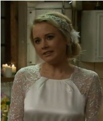 Jess's hair idea. Nicole off Shortland Street. Bling style side band with feather flower piece   side up-do