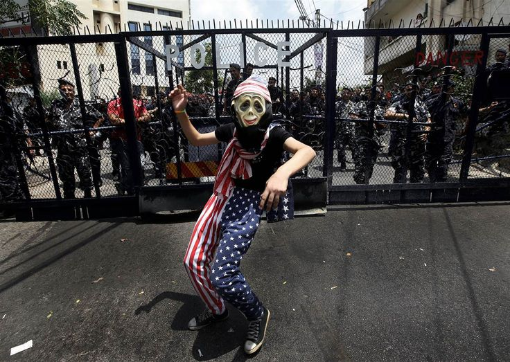 Israeli-Gaza Conflict Sparks Worldwide Protests - NBC News.com  A supporter of the Palestinian Communist group attends a protest against the Israeli offensive in Gaza, as Lebanese riot policemen block a road that leads to the US embassy in Aukar, east of Beirut, Lebanon, on Sunday. Hussein Malla / AP