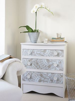 Chest of drawers, transformed with paint and wallpapered. Lace effect