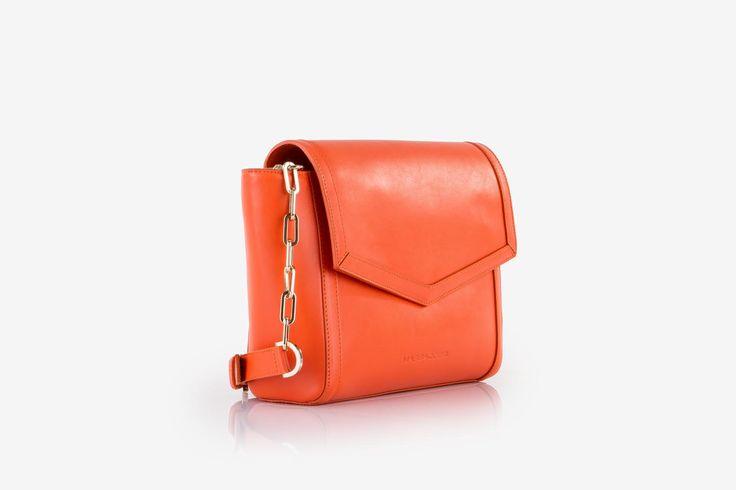 Zhoe in orange cow-hide leather. Side view.