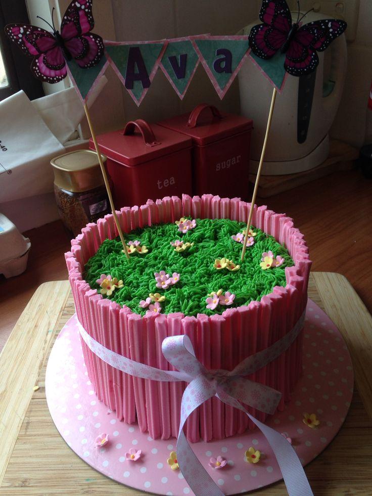 Girls birthday. Garden cake. Musk sticks and butter cream with sugar paste flowers.
