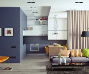 This colorful apartment in Kiev was designed by Andrew Sokruta – filled with oceanic and tropical hues throughout. Immediately, the most noticeable feature is the large volume that separates the kitchen from the hallway to the left. It houses some extra storage on the kitchen side in addition to providing a nice interior compartment for added useable space accessible from the hall.