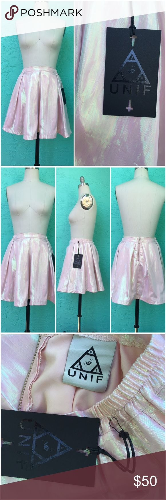 """UNIF Cheerleader Mini Skirt NWT. Beautiful pastel pink with an iridescent sheen to it. Waist band has elastic on sides and there is an exposed zipper in back. 100% polyester fabric with a poly/spandex lining . *Please note this is a size Large (I close-pinned it to fit the size 8 dress form) Measurements: (taken while laying flat so double for waist and hips) Waist: 15""""-16"""" Hips: 22"""" Length: 17.5"""" UNIF Skirts Mini"""