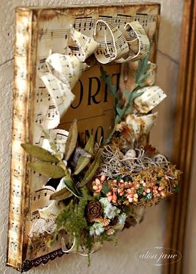 "A beautiful altered canvas with sheet music, faux greenery and a ""bird's nest."" As seen on Life is a Beautiful Place To Be."
