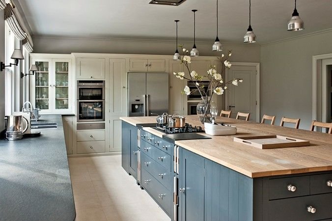 I like the look of this color scheme, the wide island with wood top, and the lights.
