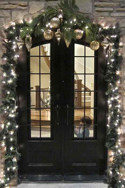 festive door decor - and that tiny cutie. bless.
