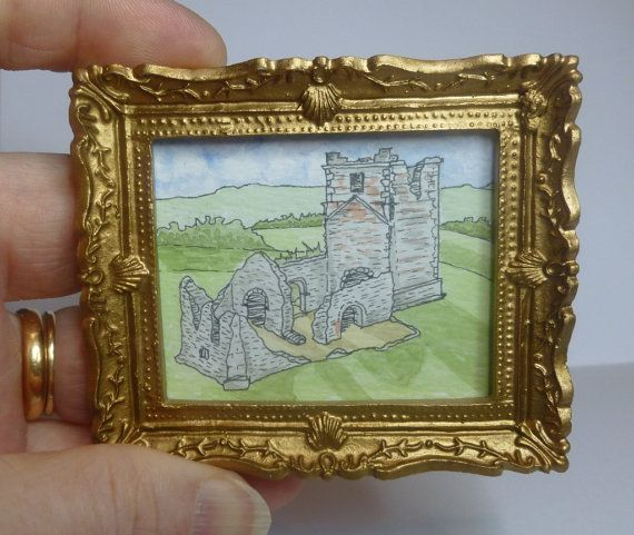 A framed, miniature original ink and watercolour painting of the ruins of Knowlton Church, Cranborne, Dorset, England.  It measures 7.5cm x 6.5cm