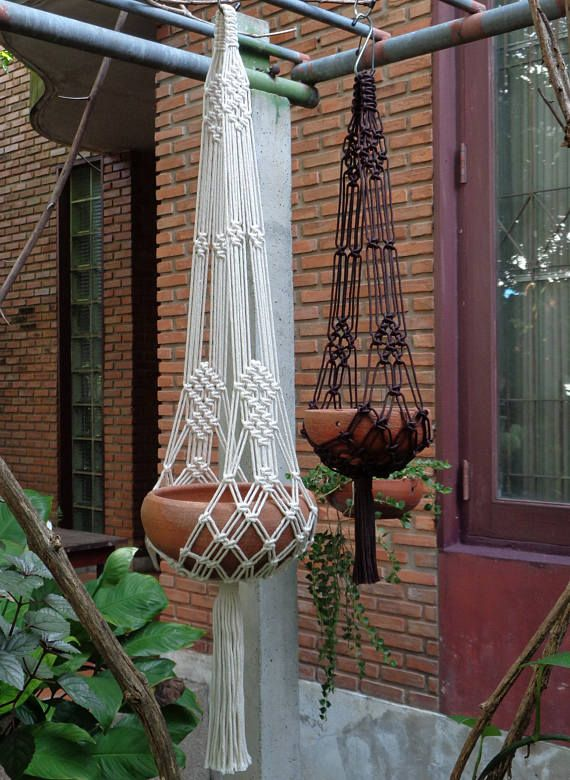 """Two pieces of 2 arms Macramé Plant Hanger in Extra-X set; The first hanger Extra X in natural white unbleached poly cotton twisted cord (off- white color), perfect for 8- 9"""" (20-23 cm) diameter x 4(10 cm) height plant pot. The hangers length without pot (top of the hanger to end of its tassel) is 41"""" (104 cm). The second hanger Model X in dark brown nylon braided cord, perfect for 6 - 7 ½"""" (15-19 cm) diameter plant pot. The hangers length without pot (top of the hanger to end of its tassel)…"""