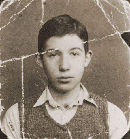 Damaged photograph of Dov Levin, a Jewish school boy in pre-war Kovno, that was preserved through the war by a friend in the sole of her sho...