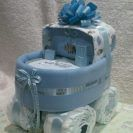 Blue Baby Carriage Diaper Cake: Bouncing Baby Diaper Cakes by Nichole is a very affordable diaper cake business.  All cakes under $90. Will work with budget & design ideas!  You may also