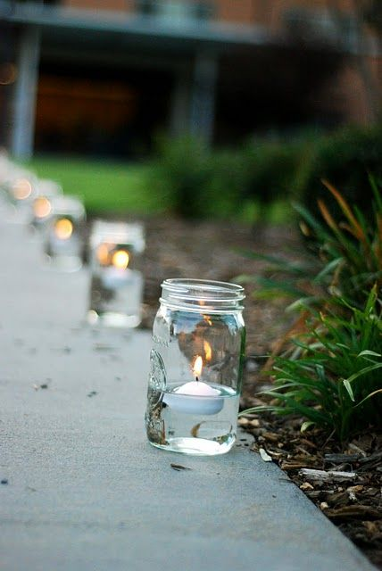 floating candles in mason jars. love this idea