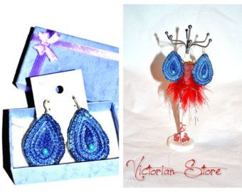 Embroidery earrings with traditional pattern and blue pearls
