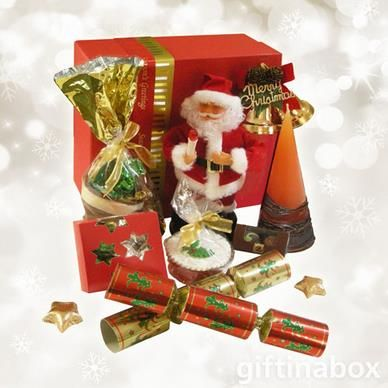 A gourmet gift containing a sensational selection of Festive Season treats to be enjoyed with your very own singing Santa Claus. All goods are lovingly presented in a red festive season gift hamper box decorated with gold ribbons and tissue paper.  Musical Santa Claus Milk Chocolate Christmas boot with chocolate filling Mini Christmas cake Gold decorative Christmas bells Pack of 10 caramel-chocolate stars 2 x Chocolate twist wrap balls 2 x Chocolate lollipops 2 x Christmas crackers