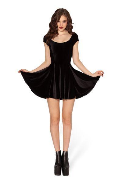 Shop this look on Lookastic: https://lookastic.com/women/looks/black-velvet-skater-dress-black-chunky-leather-ankle-boots/14044   — Black Velvet Skater Dress  — Black Chunky Leather Ankle Boots
