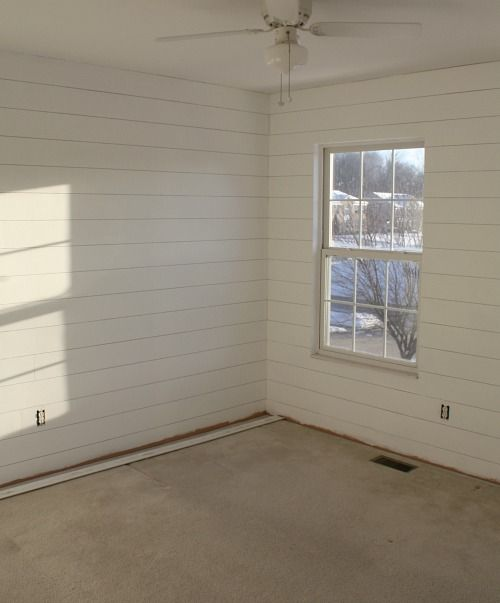 shiplap hung and painted in bedroom