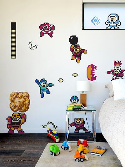 I like this. You can get a pair of sheets (made from Re-Stik™ vinyl, oh yeah) that contain dozens of Mega Man wall decorations. The whole re-stick thing me