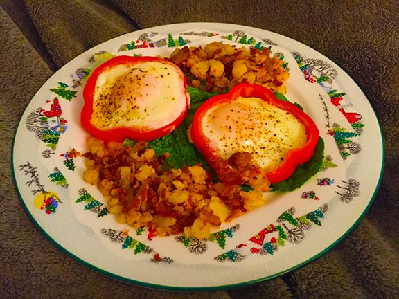 MERRY, MERRY BREAKFAST IN BED. Red pepper rounds with spicy turkey hash browns on romain leaf.