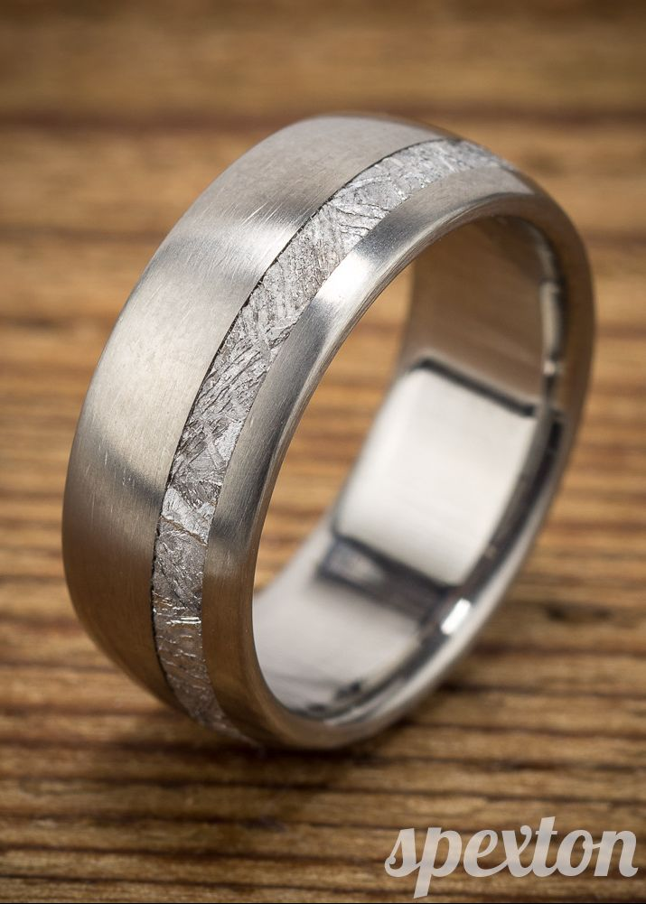 Titanium and Gibeon meteorite wedding ring by Spexton.  Blending modern design with ancient materials, this wedding band is uniquely handmade in the USA.