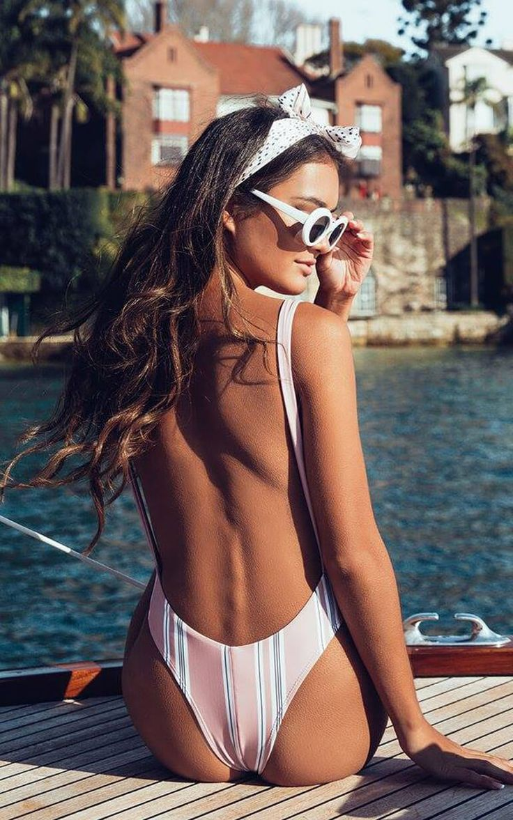 Australian online fashion brand Showpo's latest swim range features pop-bright red bikinis, fiery sexy silhouettes, and barely-there 'kinis.