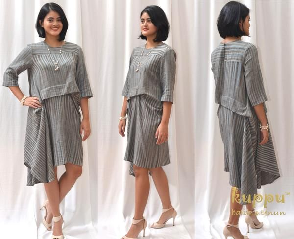 ASYMMETRIC GREY STRIPES DRESS  by: Kuppu Batik & Tenun  1.350.000,00  Details  100% cotton, hand-woven natural-dye Tenun Bali, Indonesia Colour: stripes of grey & dusty blue Fashionable asymmetrical design Medium size: Bust 94cm, Arm 44cm, Height 93cm long from highest shoulder point Dry clean or hand wash with mild soap only - hang to dry, avoid direct sunlight - low heat iron on batik tenun part  www.kuppubatiktenun.com  More info  Laura 08119103668 Pin BB 751E6162 Line ID kuppubatiktenun