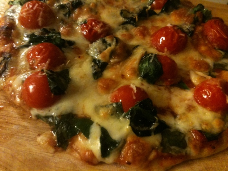 tomato and spinach home made pizza! baking on the stone is very good idea.