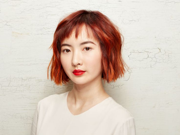 Aveda Artists David Anders Palmira and Sarah Sibley teamed up to create this undone wavy bob and bright red Aveda hair color.