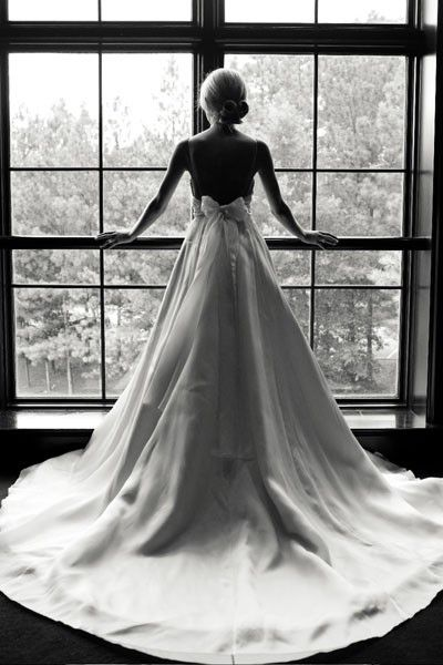 11 stunning wedding dresses with dramatic dressing - including this dress with a low back and pretty bow