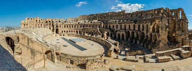 Panoramic view of the Amphitheatre of El Jem, an archeological site in the city of El Djem, Tunisia. The amphitheatre, a UNESCO World Heritage Site since 1979, was built around 238 AD, when the modern Tunisia belonged to the Roman province of Africa. It is the third biggest amphiteatre and one of the best preserved Roman ruins in the world with capacity for 35,000 spectators within 148 metres (486 ft) and 122 metres (400 ft) long axes and a unique in Africa.