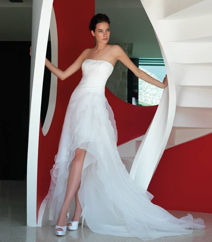 A very elegant and sensual dress... from Italy.   It is short in front and long in back, in organza.     -- Ask information, if you like it, to www.dream-weddings-in-italy.com/dream_wedding_in_italy_contacts.php?ogg=T01