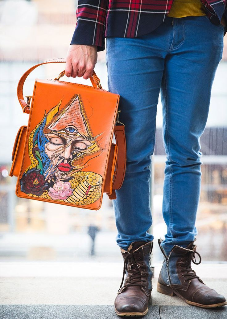 An awesome vintage leather messenger bag for men in a cognac colour with designs from Ethnic theme: intricate folk motifs mixed to abstract patterns with eyes and snakes. The front side is decorated with a beautiful eagle. #sac #print #handmade #homme #motif #vintage #cartable #bandoulière #customisé #fait main #ethnique #aigle #oeil leather #кожа #cuir #couro #leder #pelle #cuero #bag #print #handmade #man #pattern #vintage satchel #shoulder