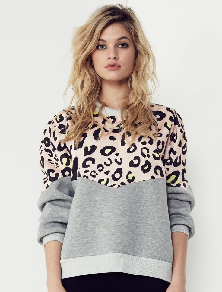 EVOLVE SWEATER Bringing a little of your wild side to an everyday utility look, the combo of leopard print and sports luxe grey marle makes this anything but an average sweater. Available: www.talulah.com.au/shop/isla-by-talulah/tops